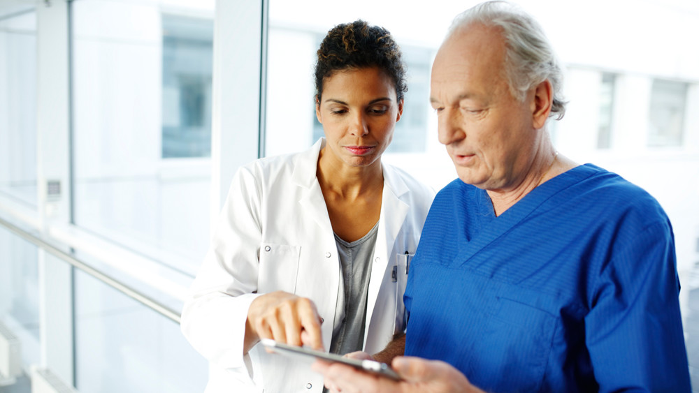 Wellspect About Healthcare professionals analysing data on tablet